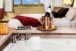 The perfect room for a romantic evening. Order a bottle of champagne and sink into the 2-person jetted spa tub for a nice relaxing soak, before crawling into the California King-sized bed.